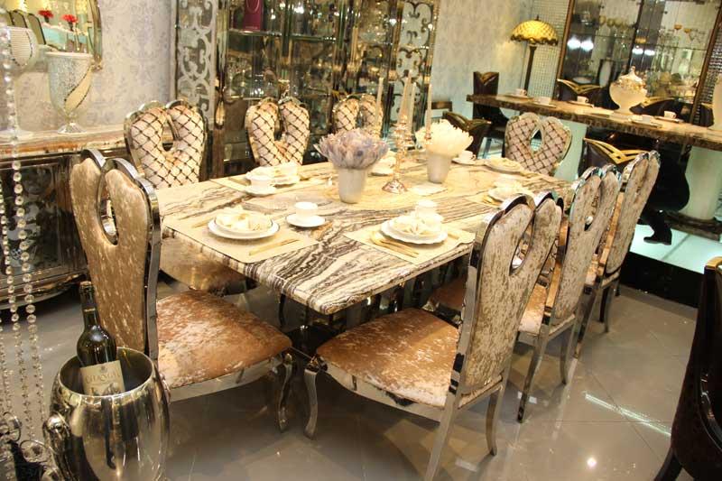Столы обеденные с столешницей из натурального камня